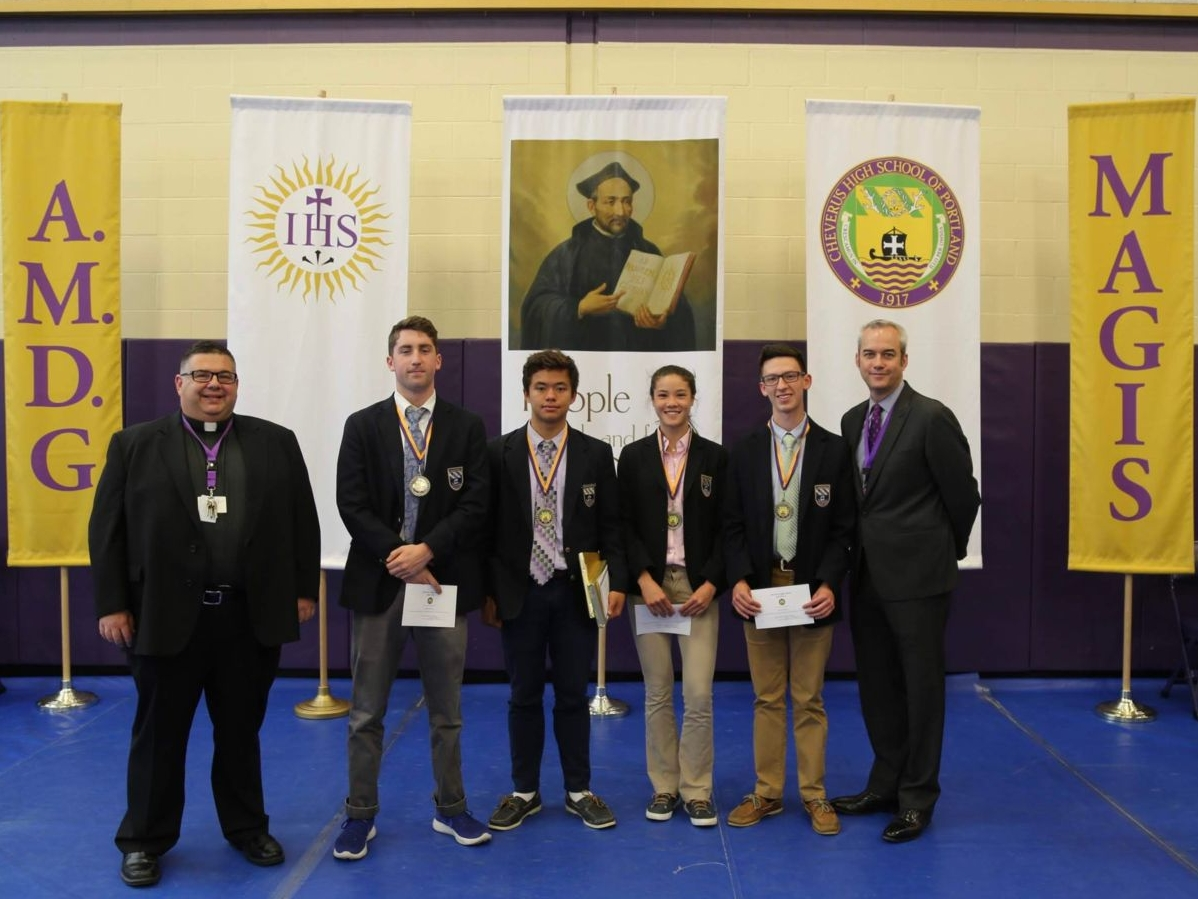 Fr. Pecoraro, George Mitchell, Lawrence Bossong, Sophie Schuele, Nathan Jacobs and Principal John Moran.